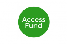 Access Fund in white lettering on a green circle background