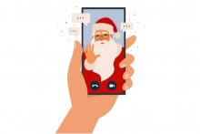 A hand holding a mobile phone with Santa on it. There are speech bubbled around Santa.