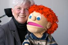 Sue Morgan holding a Kids on the Block puppet